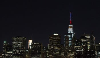The spire of One World Trade Center in New York City is lit in French flag colors in solidarity with France after a series of terror attacks in Paris, November 13, 2015.
