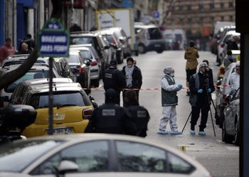 Forensic scientists and police inspect an area in Paris' 11th district on November 14, 2015, following a series of coordinated attacks in and around Paris late Friday which left more than 120 people dead.