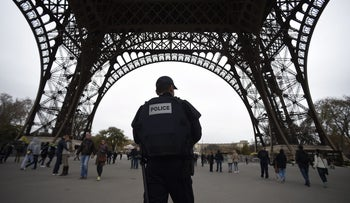 Police patrol at the Eiffel Tower in Paris, which was closed following the previous day's terror attacks, November 14, 2015.