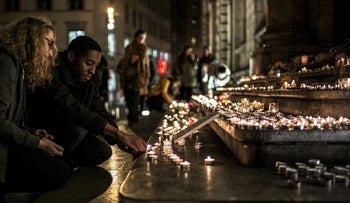 People light candles in tribute to the victims of Paris' attacks,  on November 14, 2015 in Terreaux quarter on the esplanade of Lyon town hall.