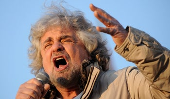 Five-Star Movement leader and comedian Beppe Grillo gestures during a rally in Turin, Italy February 16, 2013.