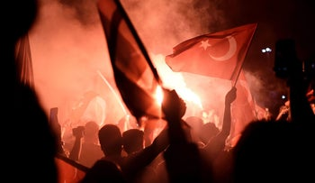 Pro-Erdogan protesters gather at Taksim square in Istanbul to support the government following a coup attempt, July 16, 2016.