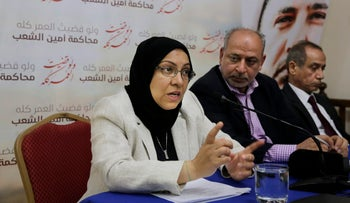Lawyer Jalila al-Sayed, left, speaks to journalists as Abduljalil Khalil, a senior member of Al-Wefaq political society, center, and lawyer Hassan Radhi, right, listen during a press conference in Manama, Bahrain, May 30, 2016.