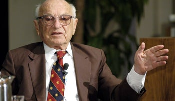 Nobel Prize winning economist Milton Friedman speaking a conference honoring him, hosted by the Federal Reserve Bank of Dallas, October 24, 2003. Friedman is shown gesturing with his left hand.