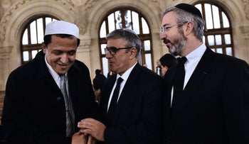 Rabbi Moshe Sebbag and Imam Hassene Chalghoumi arrive at the Grande synagogue de la Victoire before a memorial service for the victims of the Paris attacks, November 15, 2015.
