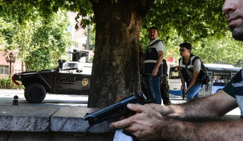 Turkish police officers operate in front of the courthouse in Ankara, July 18, 2016.