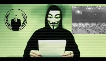 A man in a Guy Fawkes mask threatens ISIS with cyberattacks. November 16, 2015.