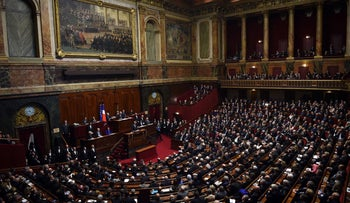 French President Francois Hollande delivers a speech to members of Parliament during an exceptional joint gathering of Parliament in Versailles on November 16, 2015, three days after 129 people were killed in the worst terrorist attack in France's history.