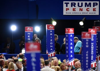 A Trump/Pence poster over the convention floor on the opening day of the Republican National Convention at the Quicken Loans arena in Cleveland, Ohio on July 18, 2016.