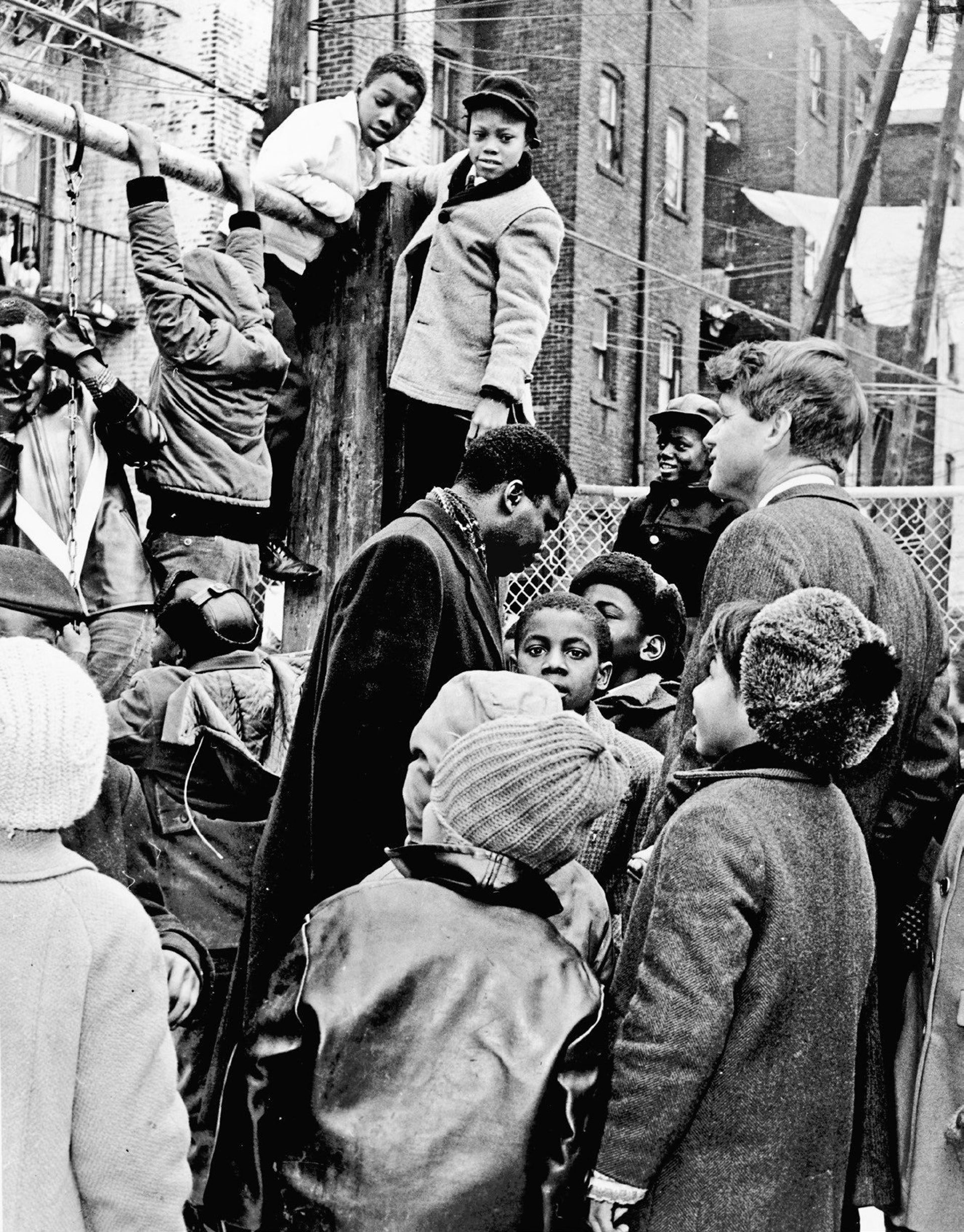 Senator Robert F. Kennedy visiting with the children who were his favorite constituents, this time at a playground in Brooklyn