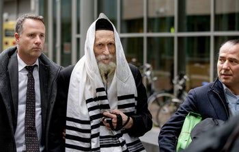 Rabbi Eliezer Berland, who is suspected of sexual abuse in Israel, arrives at court in Haarlem, the Netherlands, November 17, 2014.