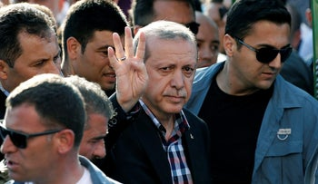 Turkish Erdogan waves to the crowd following a funeral service for a victim of the thwarted coup in Istanbul, Turkey, July 17, 2016.