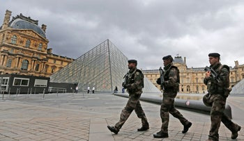 French soldiers patroling in the courtyard of the Louvre Museum in Paris, November 17, 2015.