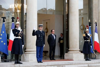 French President Francois Hollande stands outside at the Elysee Palace, in Paris. November 17, 2015.