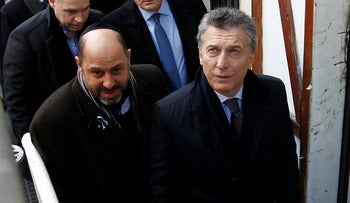 Argentine President Mauricio Macri (right) attends a ceremony marking the anniversary of the bombing of the AMIA Jewish center in Buenos Aires on July 18, 2016.
