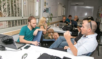 People work at the Herzliya Accelerator Center, February 26, 2015.