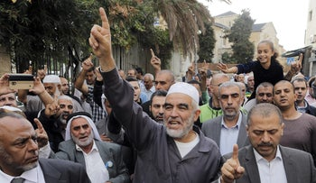 Sheik Raed Salah, leader of the Islamic Movement's northern branch, leaves the Jerusalem district court, October 27, 2015.