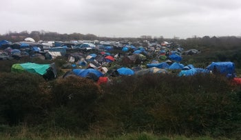 Tents at a makeshift refugee camp in Calais, France. Residents describe increased police activity.