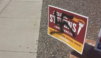 A swastika painted on one of Adam Stevens' campaign signs.