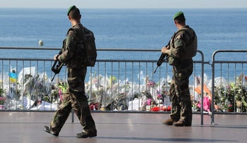 Soldiers pass by the new makeshift memorial in tribute to the victims of the deadly Bastille Day attack at the Promenade des Anglais, Nice, France, July 19, 2016.