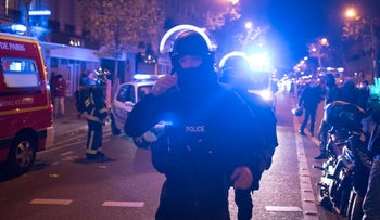 Elite police officers outside the Bataclan theater in Paris, November 13, 2015.