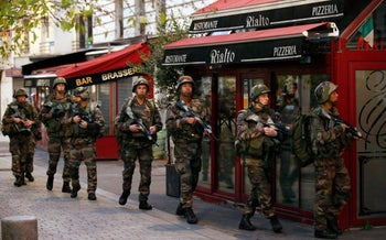 Soldiers operate in St. Denis, a northern suburb of Paris, Wednesday, November 18, 2015.