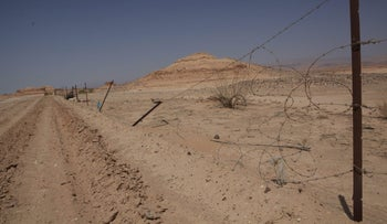 Work on a fence along the southern part of the Jordan border, September 6, 2015.