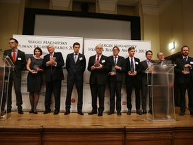 The winners of the Sergei Magnitsky Human Rights Awards 2015 standing together on the stage, each holding his or her award, in London, November 16, 2015.