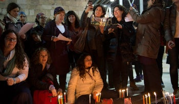 Women of the Wall, along with MKs Michal Rozin and Tamar Zandberg, hold a small Hanukkah candle-lighting ceremony at the Western Wall, December 18, 2014.