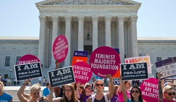 Demonstrators on both sides of the abortion issue stand in front of the Supreme Court in Washington, Monday, June 20, 2016.