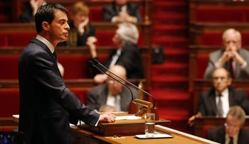 """French Prime Minister Manuel Valls addresses French lawmakers during a debate on a measure that would extend a state of emergency declared by the French president until the end of February, at the National Assembly in Paris on November 19, 2015. Prime Minister Manuel Valls warned of the danger of an attack in France using """"chemical or biological weapons"""", in a speech to lawmakers debating the extension of a state of emergency."""