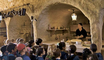A woman gives a workshop at the Eretz Israel Museum in Ramat Aviv.