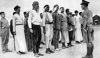 "Arab ""rookies"" lining up in a barracks square in Palestine on Dec. 28, 1940 for their first drill under a British soldier."