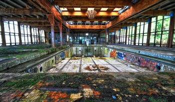 This was an indoor swimming pool at the grand Grossinger's Catskill Resort Hotel near Liberty, New York. The hotel closed in 1986, since when the entire compound has been neglected. The picture shows the ruins of the pool, its walls covered in graffiti - but the past elegance still shining through.