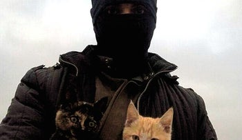 An ISIS fighter with a cat.