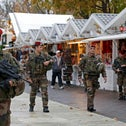 French soldiers patrol the Christmas market on the Champs-Elysees in Paris, France, November 19, 2015.