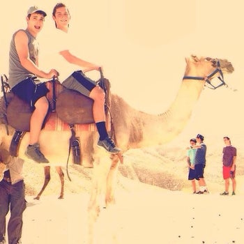 Ezra Schwartz, on the left, with long-time friend Geoffrey Cahr on a camel ride in Israel during the summer of 2014