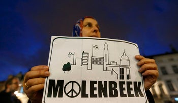 Residents of the Brussels suburb of Molenbeek take part in a memorial gathering to honor the victims of the recent deadly Paris attacks, in Brussels, Belgium, November 18, 2015.