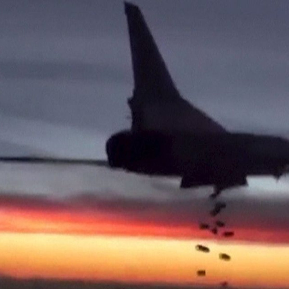 In this photo released by the Russian Defense Ministry, a Tupolev TU-22 bomber conducts an airstrike in Syria, November 19, 2015.