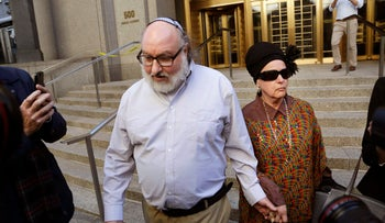 Convicted spy Jonathan Pollard and his wife, Esther leave the federal courthouse in New York, Nov. 20, 2015.