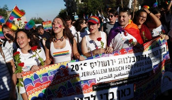 People march in the Jerusalem gay pride parade, July 21, 2016.