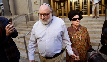Convicted spy Jonathan Pollard and his wife, Esther leave the federal courthouse in New York, November 20, 2015.
