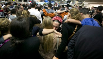 Hundreds of mourners gather at Ben-Gurion International Airport on Nov. 21, 2015 to part from Ezra Schwartz, who was killed in a terror attack.