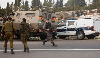 Israeli soldiers in Halhul junction, north of Hebron, in early November, 2015.