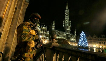 A Belgian soldier stands guard over the Grand Place of Brussels as police searched the area during a continued high level of security following the recent deadly Paris attacks, in Brussels, Belgium, November 22, 2015.
