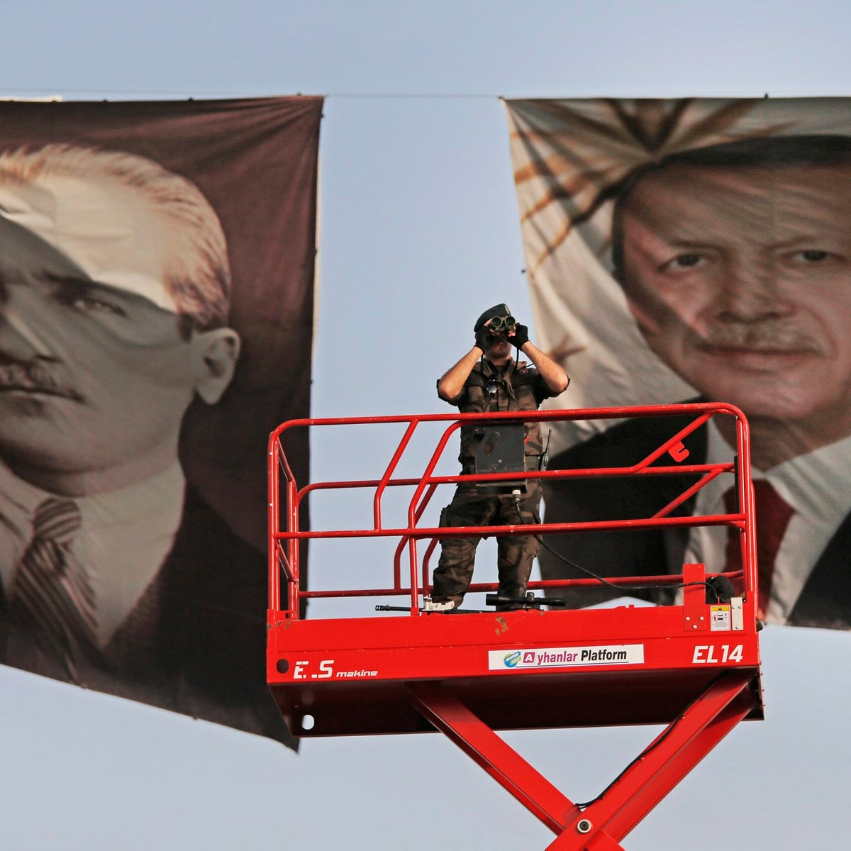Posters of Turkish Republic founder Mustafa Kemal Ataturk, left, and Turkey's current President Recep Tayyip Erdogan