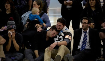 Friends of Ezra Schwartz grieving for the American terror victim at a service at Ben-Gurion International Airport in Israel on Nov. 21, 2015, before the body was repatriated to Boston for his funeral.