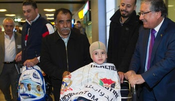 Ahmed Dawabshah and his grandfather Hussein at the airport in Madrid on their way to meet Real Madrid soccer players in March, 2016.