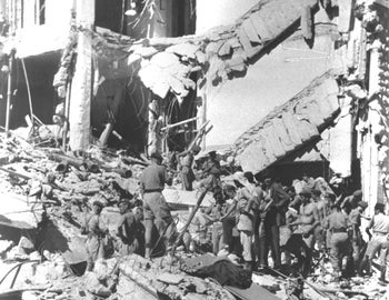 Rescue workers search the ruins of Jerusalem's King David hotel, blown up by the Etzel underground militia in 1946.