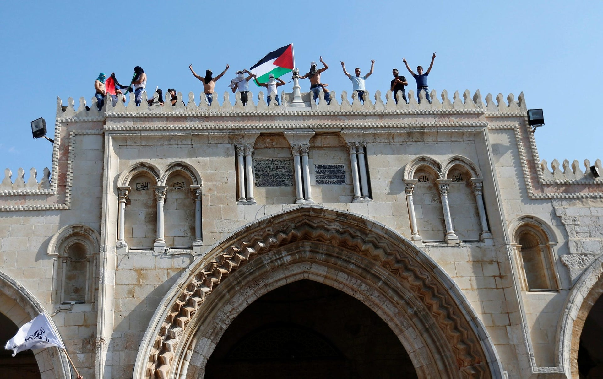 Palestinians gather at the Temple Mount compound after Israel removed all security measures it had installed there, in Jerusalem's Old City July 27, 2017.